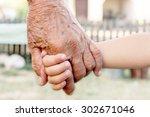 grandchild holding grandparent...   Shutterstock . vector #302671046