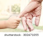 young child holding her... | Shutterstock . vector #302671055