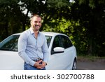 Stock photo handsome man on the background of car 302700788