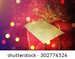 christmas gift box with... | Shutterstock . vector #302776526