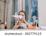 small girl doing applique | Shutterstock . vector #302779115