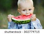 cute little boy eats big... | Shutterstock . vector #302779715