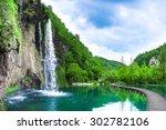 Waterfall In Mountain Lake And...