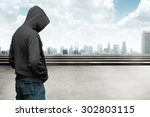 Faceless Man In Hood With...