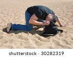 photographer on the beach using ... | Shutterstock . vector #30282319