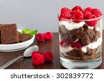 a glass of parfait with... | Shutterstock . vector #302839772