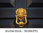 Close Up Of Lion Headed Door...