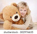 little girl cuddling with her... | Shutterstock . vector #302976635