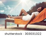 young woman relaxing on her... | Shutterstock . vector #303031322