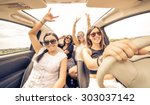 four girls driving in a... | Shutterstock . vector #303037142