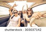 four girls driving in a... | Shutterstock . vector #303037142
