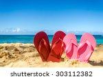 red and pink flip flops in... | Shutterstock . vector #303112382