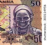 Small photo of 50 Gambian dalasi bank note. Gambian dalasi is the national currency of Gambia