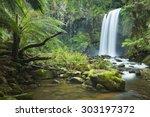 Waterfall In A Lush Rainforest. ...