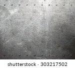 metal texture with rivets | Shutterstock . vector #303217502