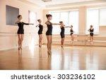 dancer is doing exercises in... | Shutterstock . vector #303236102