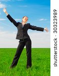 happy woman in black costume standing at the green field - stock photo