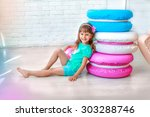 girl smiling on the floor with... | Shutterstock . vector #303288746