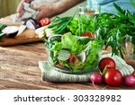 salad of summer vegetables in a ... | Shutterstock . vector #303328982