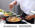 chef in restaurant kitchen...   Shutterstock . vector #303350096