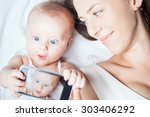 funny baby girl make selfie on... | Shutterstock . vector #303406292