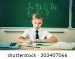 boy thinking and sits at a desk ... | Shutterstock . vector #303407066