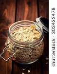 muesli in open glass jar on... | Shutterstock . vector #303433478
