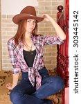 Attractive Girl In Cowboy Hat...