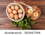 boiled eggs on a wooden... | Shutterstock . vector #303467396