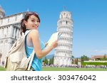 Stock photo happy woman travel in italy leaning tower of pisa 303476042