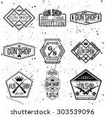 gun shop logotypes and badges  | Shutterstock .eps vector #303539096