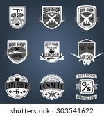 gun shop logotypes and badges  | Shutterstock .eps vector #303541622