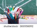 colorful pencils of red yellow... | Shutterstock . vector #303558392