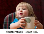 cute little blond girl with cup ... | Shutterstock . vector #3035786