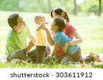 boys with family in the summer... | Shutterstock . vector #303611912