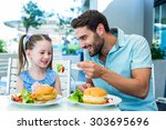 daughter and father eating at... | Shutterstock . vector #303695696