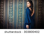 portrait of a beautiful... | Shutterstock . vector #303800402