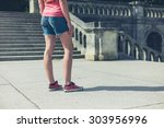 a young woman is standing near... | Shutterstock . vector #303956996