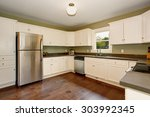 Stock photo classic kitchen with green interior paint hardwood floor and white cabinets 303992345