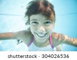 Joyful Girl Swimming Underwate...