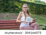 student sitting in park near...   Shutterstock . vector #304166075
