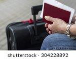 Red Passport In Female Hands...