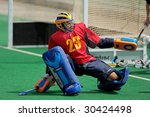 BLOEMFONTEIN, SOUTH AFRICA - MARCH 14: A goalkeeper in action during an international men's field hockey game between Germany and South Africa March 14, 2009 in Bloemfontein. Germany won 4-3. - stock photo