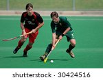 BLOEMFONTEIN, SOUTH AFRICA - MARCH 14: Players in action during an international men's field hockey game between Germany and South Africa March 14, 2009 in Bloemfontein. Germany won 4-3. - stock photo