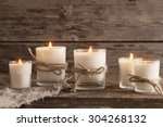 Scented candles on old wooden...