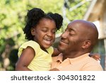 father holding his daughter and ... | Shutterstock . vector #304301822