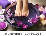 female feet at spa pedicure... | Shutterstock . vector #304341095