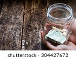 Man Holding A Glass Jar For...