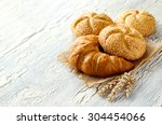 croissant and small loaf with... | Shutterstock . vector #304454066