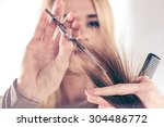 close up of a hairdresser... | Shutterstock . vector #304486772